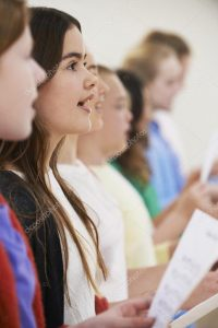 depositphotos_70422541-stock-photo-group-of-school-children-singing